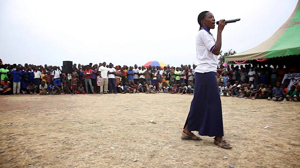 Community Health Worker, Diana Nguka, performing a Maji Safi Group original song