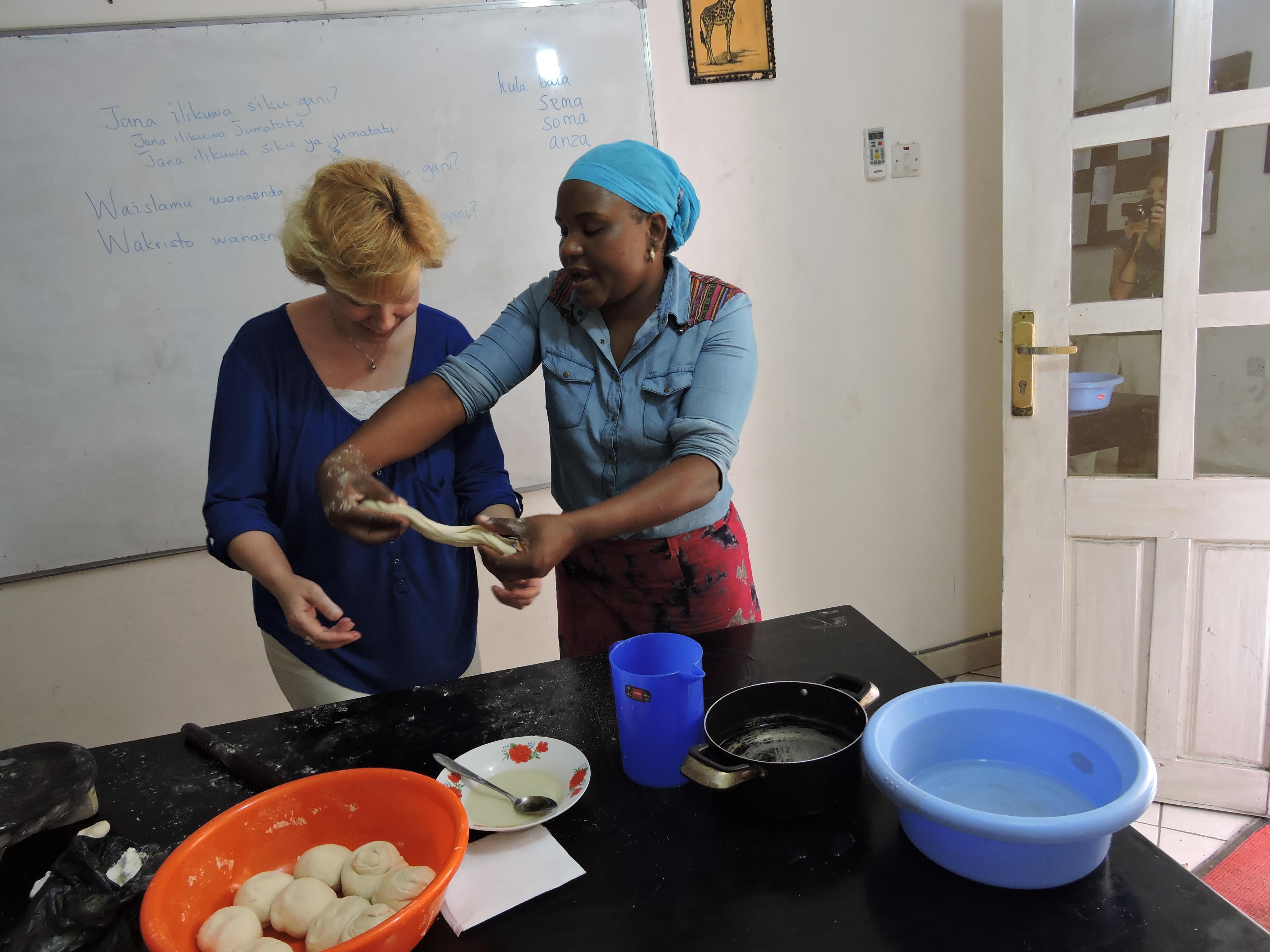 Susan learning how to make Chipati (Tanzanian fried bread).
