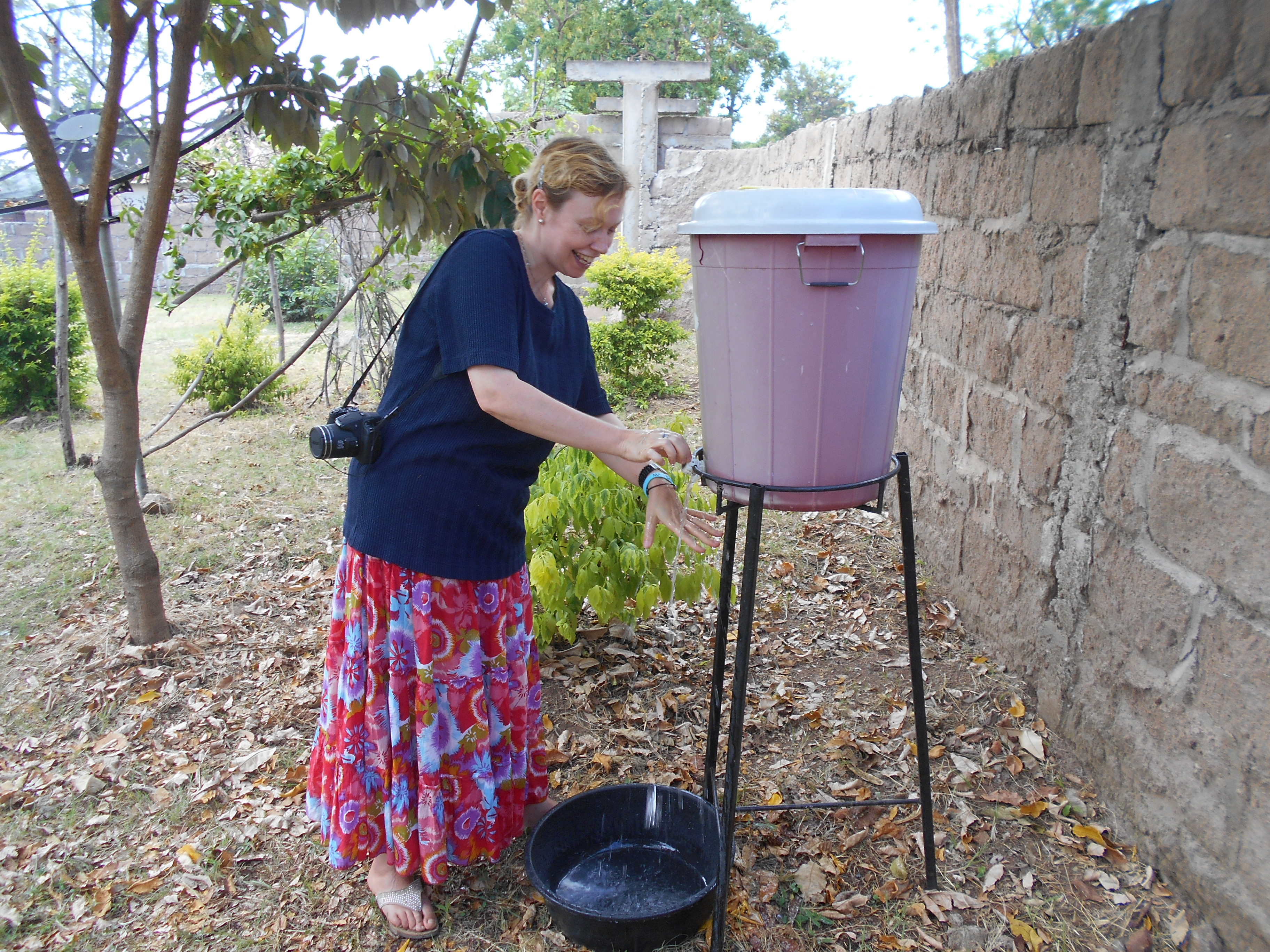 Susan washing her hands in Shirati